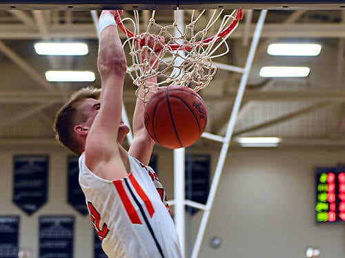 Versailles' Justin Ahrens dunks during an Ohio High School Athletic Association regional semifinal boys basketball game against Roger Bacon on March 15 at Fairmont's Trent Arena in Kettering.