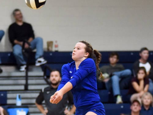 Tri-Village's Kara Hollinger passes the ball during a Cross County Conference volleyball match against Newton on Tuesday in New Madison.