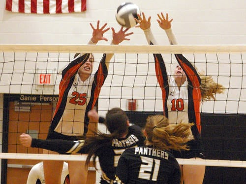Versailles' Lindsey Winner (25) and Payton Berger (10) go up for a block during a Midwest Athletic Conference volleyball match against Parkway on Sept. 7 in Versailles.