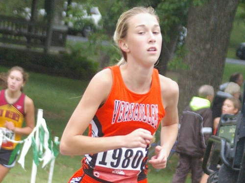 Versailles' Liz Watren runs during the Treaty City Invitational cross country meet on Sept. 2 in Greenville.