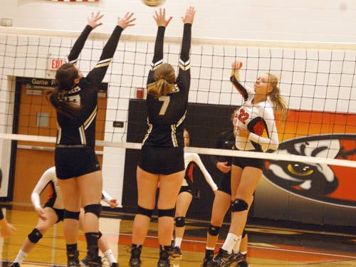 Versailles' Mallory Marshal hits the ball over the net during a Midwest Athletic Conference volleyball match against Parkway on Sept. 7 in Versailles.