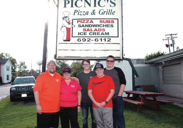 Charlie and Sarah Billenstein, far left, purchased Picnic's Pizza in August. Sarah hopes it will be a good place for young people in the area to work.