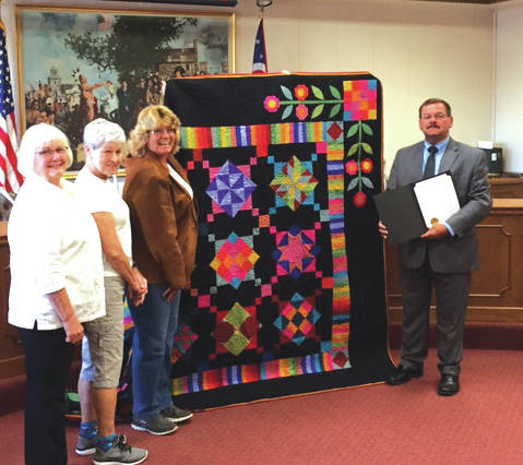 Towne Squares Quilt Club president Kathy Street, vice-president Chris Stamcoff and program committee chairman Toni Heggie were on hand as Greenville Mayor Steve Willman signed a proclamation declaring the week of September 24 as Quilt Week in Greenville.