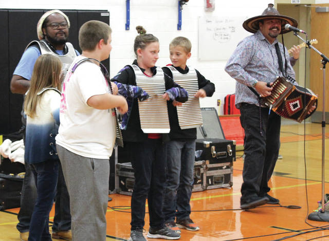Simien invited Ansonia Elementary School students on stage to accompany the band using the frottoir, a traditional Cajun instrument resembling a washboard.