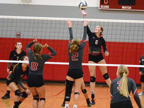 Arcanum's Audrey Heiser goes up for a kill during a volleyball match against Dixie on Monday in New Lebanon.