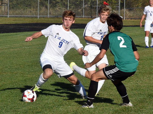 Franklin Monroe's Brydon Diceanu dribbles the ball during a Cross County Conference boys soccer game against Bethel on Sept. 28 in Pitsburg.