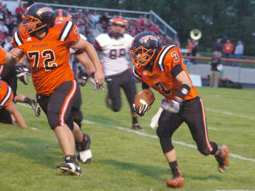 Ansonia's Cody Sanders carries the ball during a Cross County Conference football game against Arcanum on Sept. 8 in Ansonia.