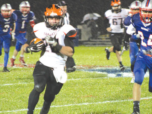 Arcanum's Daniel Coats runs during first-quarter action Friday night. The visiting Trojans defeated the Tri-Village Patriots 37-8.