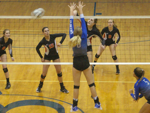 Versailles' Danielle Winner goes for a kill during an Ohio High School Athletic Association sectional championship volleyball match on Thursday at Brookville.