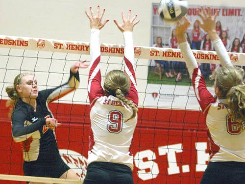Versailles' Elizabeth Ording goes up for a kill during a Midwest Athletic Conference volleyball match against St. Henry on Thursday in St. Henry.