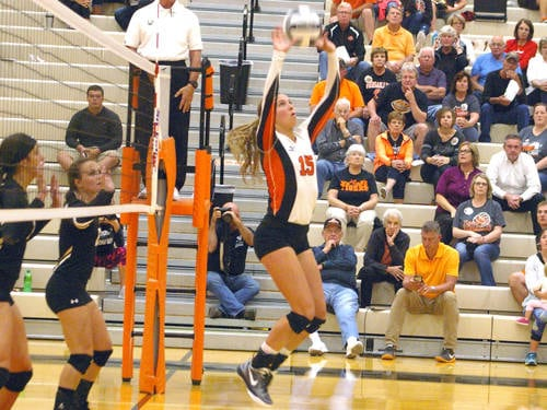 Versailles' Ellen Peters sets the ball during a Midwest Athletic Conference volleyball match against Parkway on Sept. 7 in Versailles.