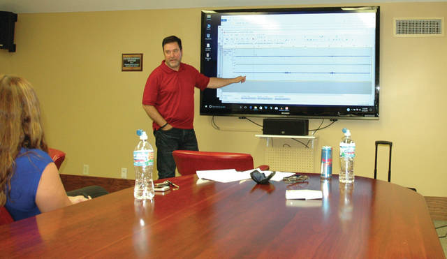 Ohio ghost hunter and author James Willis delivers a presentation on his team's findings to a client.