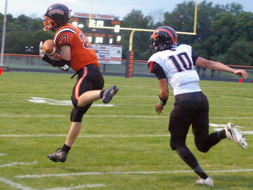 Ansonia's Hunter Muir makes a catch during a Cross County Conference football game against Arcanum on Sept. 8 in Ansonia.