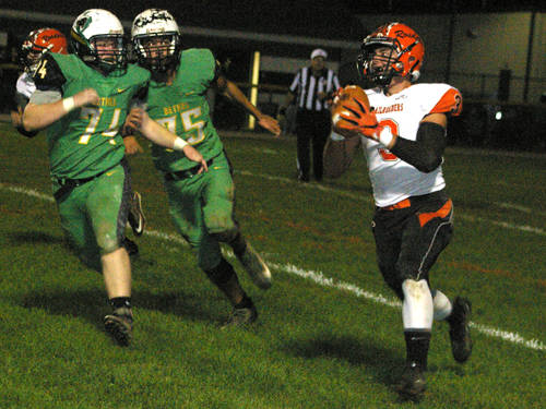 Bradford's Hunter Penkal rolls out for a pass during a Cross County Conference football game against Bethel on Friday in Brandt.