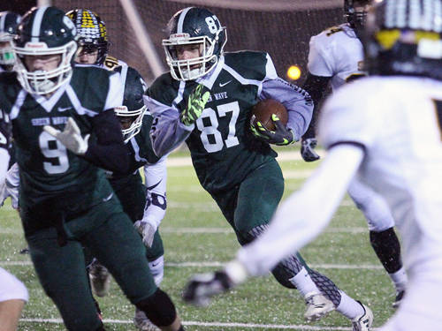 Greenville's Jacob Goldsmith carries the ball during a Greater Western Ohio Conference football game against Sidney on Friday in Greenville.