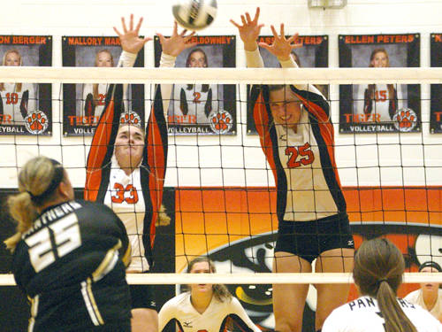 Versailles' Kelsey Custenborder (33) and Lindsey Winner (25) go up for a block during a Midwest Athletic Conference volleyball match against Parkway on Sept. 7 in Versailles.