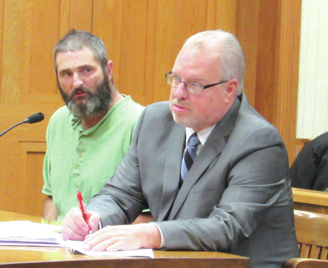 Kent Minnich (left) received community contol sanctions and 30 days house arrest after pleading guilty to one count of having a weapon under disability. He is shown in court with defense attorney Dave Rohrer.