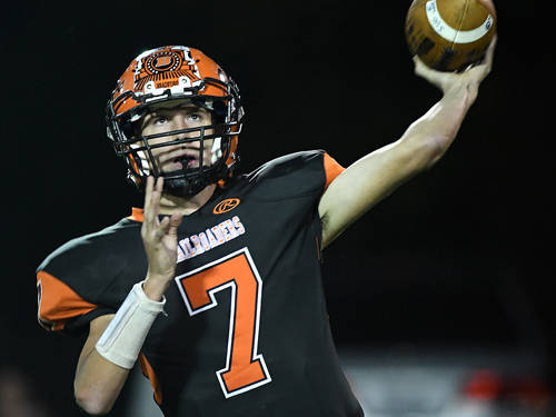 Bradford's Spencer Fischer throws a pass during a Cross County Conference football game against Covington on Friday in Bradford.