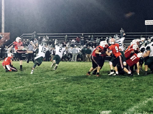 Greenville's Tyler Beyke (18) and John Butsch (2) try to block a Tippecanoe kick during a Greater Western Ohio Conference football game on Friday in Tipp City.