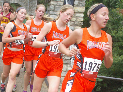 Members of Versailles' girls cross country team including Dana Rose (right) run during the Treaty City Invitational on Sept. 2 in Greenville.