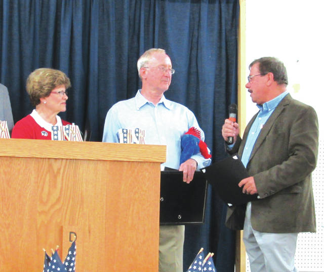 "Greenville Mayor Steve Willman (right) offers a commendation to Jim and Sherry Ward, named 2017 ""Republicans of the Year"" Sunday by the Darke County GOP."