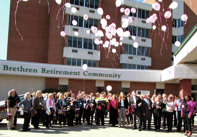 The Darke County Chamber of Commerce Chamber Women in Networking (WIN) hosted a Pink Ribbon Luncheon fundraiser for Breast Cancer Awareness of Darke County, in Greenville yesterday. Guests attached special messages to pink balloons and let them go.