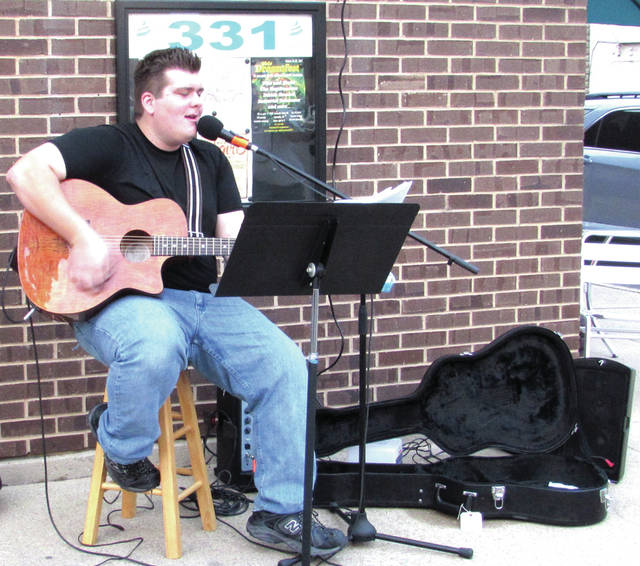 Main Street Greenville's First Friday event, October 6, featured live music from several musicians, including Noah McCabe, who sat outside of Chillz Frozen Yogurt on S. Broadway Street.