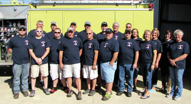 "The Village of New Madison Volunteer Fire Company had an open house Sunday. Pictured are some of the 30 members and Ladies Auxiliary members: Front row left to right: Jeremy Doolin, Casey Pearson, Joshua Doolin, Tim Shahan, Chris Pearson, Jerry Holsapple, Don Gilbert, Marcia Hunt, Lora Cook; Back row left to right: New Madison Volunteer Fire Chief Robert Cook ""Scoob, Ben Hirsch, Duane Cook, Tyler Cook, Zack Holsapple, Roger Hunt, Randy Mikesell, Denise Holsapple, Beth Wilcox and Kayla Hirsch."
