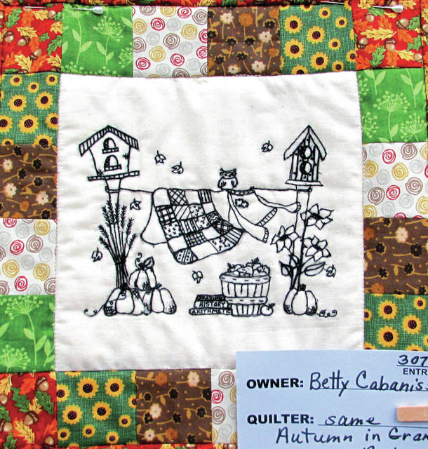 """The Towne Squares Quilt Club, of Greenville, hosted its 36th Annual Quilt Show over the weekend, featuring """"Autumn in Grandma's Backyard"""" by quilter Betty Cabaniss."""