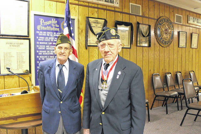 World War II veterans and DAV Honor Guard members Clark Lease and Dale Marker, who helped place the wreath in front of the Darke County courthouse during Saturday's Veterans Day parade.