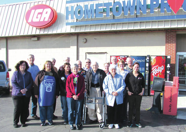 """Volunteers for the 2017 Darke County Community Christmas Drive will be """"bell ringing"""" at various businesses in the county. Shown (in no particular order) are Chris Raffel and Tom Graber, St. Mary's Church; Terry Benge and John Keller, Oakland Church of the Brethren; Carol Littman and Julie Lecklider, Community Action Partnership; Lisa Gasper, Ansonia United Methodist Church; Sharon Fellers, Grace Resurrection Community Center; Margaret Craig, Faith United Methodist Church; Bill Klein, Independent Advisor; Mike Snyder, Greenville Kiwanis; Marty Schipfer, First United Methodist Church; Shanna Camacho, Eikenberry's IGA; Kristy Cutarelli, FISH; Joe Soley, Christmas Drive Co-Chair; and Mike Boyer, Christmas Drive Treasurer."""