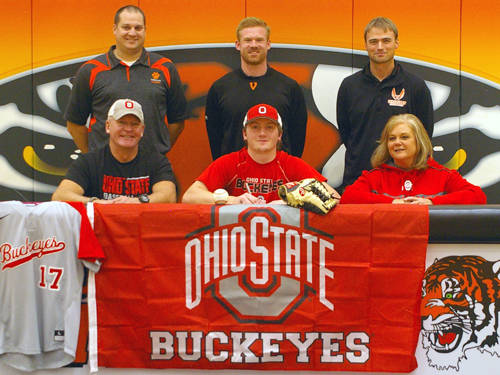 Versailles senior Cole Niekamp signed his letter of intent to play baseball at The Ohio State University. Pictured are (front row, l-r) father Stan Niekamp, Cole Niekamp, mother Diane Niekamp, (back row, l-r) Versailles assistant baseball coach Brad Koopman, Versailles baseball coach Ryan Schlater and Versailles Athletics Director Doug Giere.