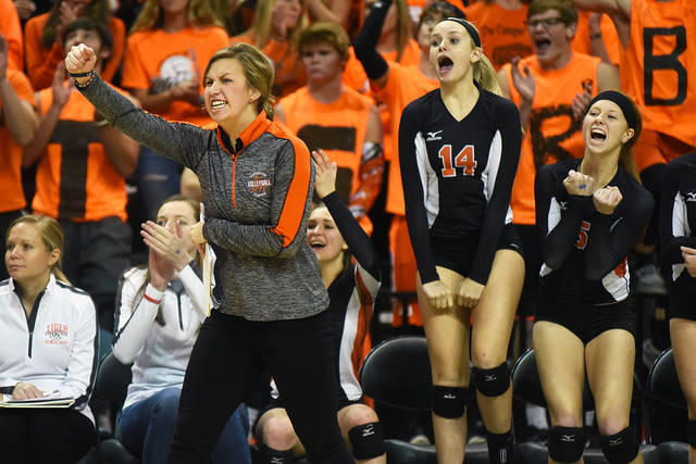 Versailles volleyball coach Kenzie Bruggeman celebrates during the Tigers' state semifinal win against Tuscarawas Valley on Friday afternoon at Wright State University's Nutter Center.