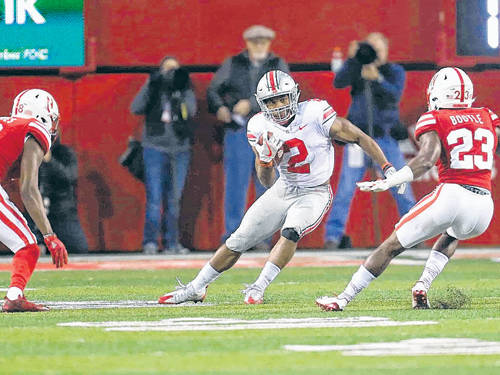 Ohio State freshman running back J.K. Dobbins makes a cut on a carry against Nebraska earlier this season.