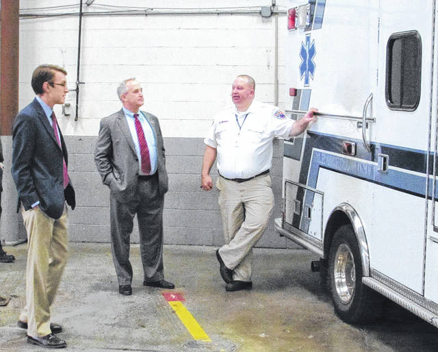Spirit Owner/Operator Brian Hathaway (right) talks with State Rep. Keith Faber and candidate Travis Faber at Spirit Medical Transport in Greenville Friday. Ambulance services are under increasing pressure to maintain profitability as Medicaid reimbursements lag.
