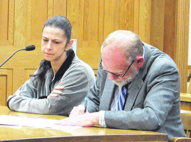 April Herrell (left, with defense attorney Randall Breaden) pleaded not guilty to methamphetamine possession in Darke County Common Pleas Court. She was one of five who were arraigned in court Monday.