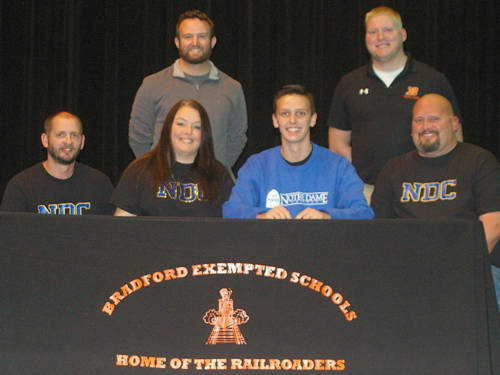Bradford's Johnny Fike committed to run for the Notre Dame College cross country and track and field programs. Pictured are (front row, l-r) stepfather Raymond Clark, mother Harmony Clark, Johnny Fike, father John Fike, (back row, l-r) Bradford cross country coach Rob Grillot and Bradford track and field coach Brian Schwieterman.