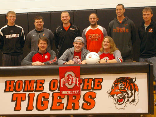 Versailles' Justin Ahrens (front center) celebrated his commitment to the Ohio State University men's basketball program on Saturday morning.