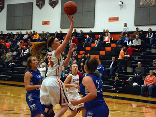 Arcanum's Lexi Unger puts up a shot during a Lady Trojan Tip-Off semifinal game against Brookville on Friday at Arcanum.