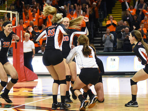 The Versailles Lady Tigers volleyball team celebrates a regional title on Saturday afternoon at Fairmont High School. The Tigers will play Tuscarawas Valley on Friday in the state semifinals.