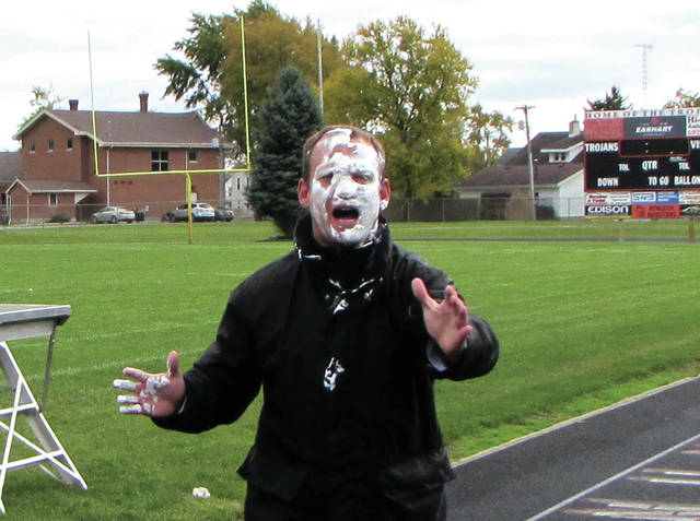Arcanum High School Principal Jason Stephan reacting to a pie thrown in his face, yesterday, in front of the student body.