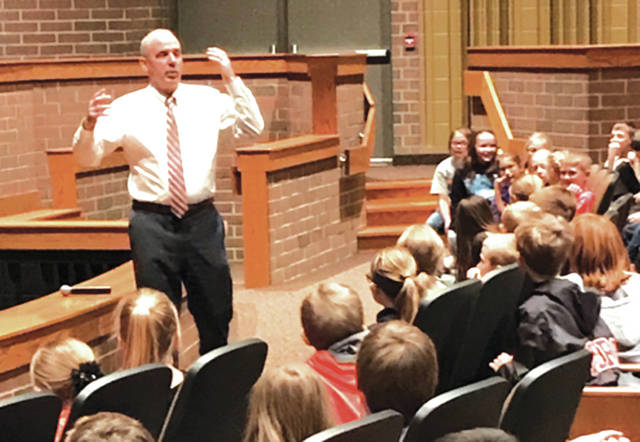 """Ohio Senator Matt Huffman (12th District), visited fourth-grade students at Versailles Exempted Village School District, on Friday. He is pictured here with the students. """"I do a long-winded explanation of government, I challenge them on their knowledge and we do a quiz bowl approach,"""" Huffman said."""