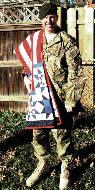 """Mary White, of West Manchester, started making her son U.S. Army Colonel Jonathan Patrick White, of Arlington, Virginia, a """"Quilt of Valor"""" the day he left for his fourth deployment to Afghanistan, in 2014. He received it a year later upon his return."""