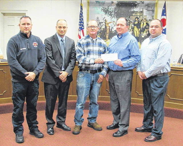 TASKS Inc. presented Greenville Fire Department with a check for $5,000 to be used for an inflatable fire safety house. Shown from left are Greenville Fire Chief Russ Thompson, Greenville Safety/Service Director Curt Garrison, Councilman John Hensley, Versailles Assistant Fire Chief Scott Garrison, and Versailles Fire Chief Brian Pearson.