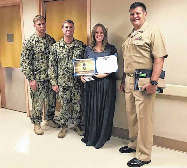 Lindsey Stacy is shown with the Purple Heart award presented to her husband, Kenton Stacy, November 18. Kenton, a 2002 Greenville High School graduate, was injured by an IED in November and is currently being treated for his injuries in San Antonio, Texas.