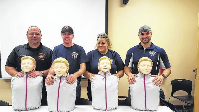 Pictured from left to right with new Little Anne CPR training manikins are Versailles EMS team members Chief Brian Pearson, Greg Wagner, Alena Wickham. and Matthew Ross.