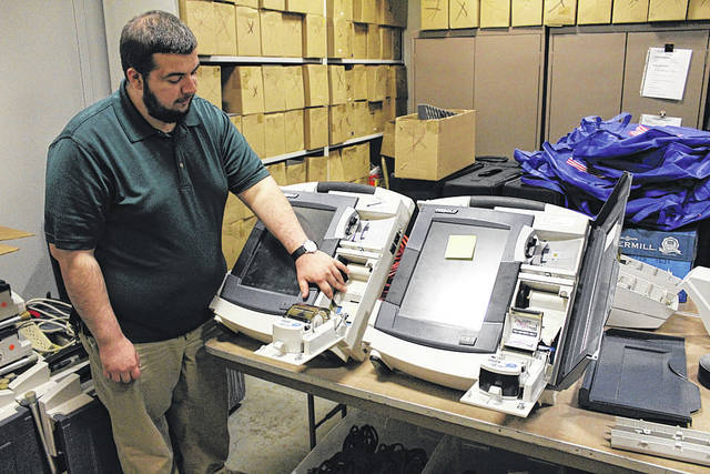 Darke County Board of Elections Director Luke Burton displays some of the county's aging voting machines. He is hoping the state will fund new equipment in time for the 2020 presidential election.