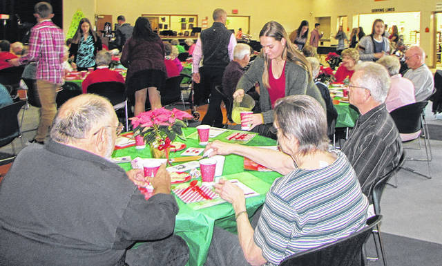 "Arcanum-Butler Local Schools hosted its fifth annual Senior Citizen Holiday Luncheon, Wednesday. ""The entire school is involved in different ways,"" Arcanum High School Principal Jason Stephan said. ""The high school students do all of the service, setting up and preparation; the middle school kids are checking the coats and welcoming the guests; the elementary students set the place mats and the pre-school students create the Christmas cards."""