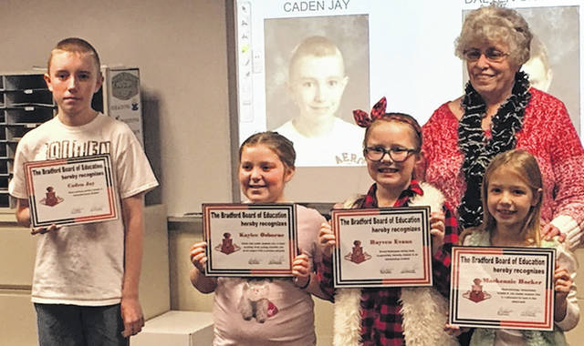 Pictured from left to right: Bradford Schools Outstanding Students of the Month: Caden Jay, Kaylee Osborne, Hayven Evans and Mackenzie Hocker were recognized at the December 14 Bradford Exempted Village Board of Education meeting. In the back row is school board member Carolyn Smith.