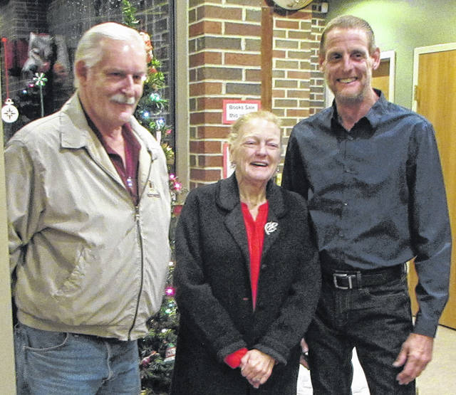 New Madison Public Library recognized Carol Bradford as Volunteer of the Year, December 12. Pictured from left to right: Bradford's cousin David Laughead, Carol Bradford and her son George Bradford.